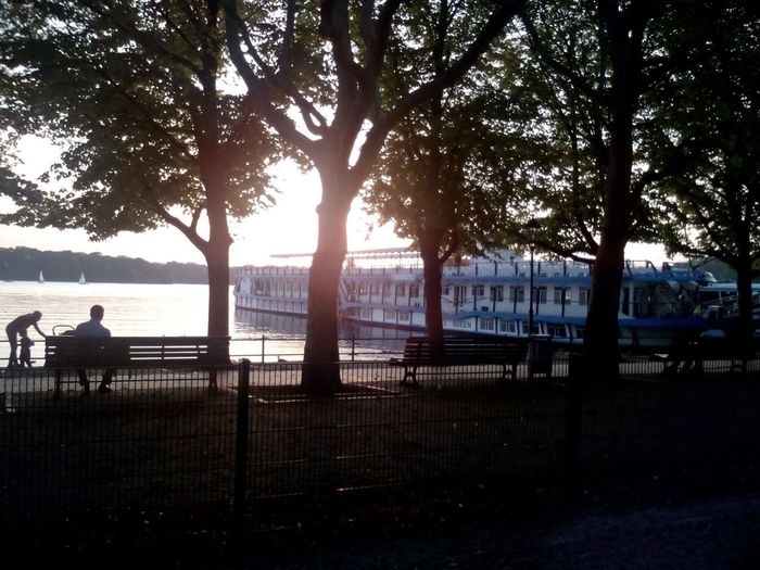 Berlin Tegel Greenwich Promenade. Nice way to have a walk EyeEm Nature Lover Tree Water Silhouette River People Tranquility Day Nature Outdoors Adult Sky Sitting Beauty In Nature Ship Dampfersteg Dampfer Steamboat Boat Germany Berlin Berliner Ansichten Greenwich Promenade Tranquility Scene Tranquility Moody Shore Tranquil Scene Adventures In The City