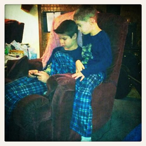 Charlie and his cousin Cameron hanging out Christmas morning.