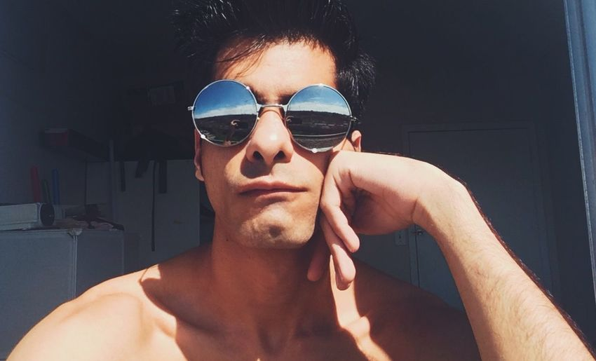 Portrait of young man wearing sunglasses