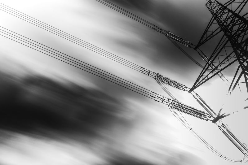 Motion Blur Cloud - Sky Low Angle View Sky No People Nature Day Outdoors Built Structure Electricity  Machinery Architecture Connection Silhouette Overcast Industry Cable Storm Motion Ceiling