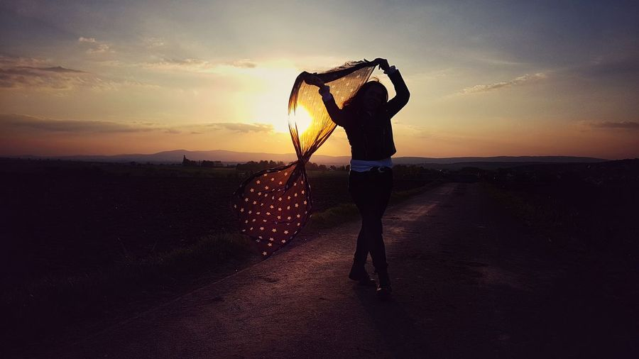 dancing in the sunset Woman Dancing In The Sunlight Romantic Enjoying The View Sunshine Love Beautiful Light And Shadow Silhouette Silhouette_collection Scarf From My Point Of View Sunset Standing Silhouette Summer Calm Countryside