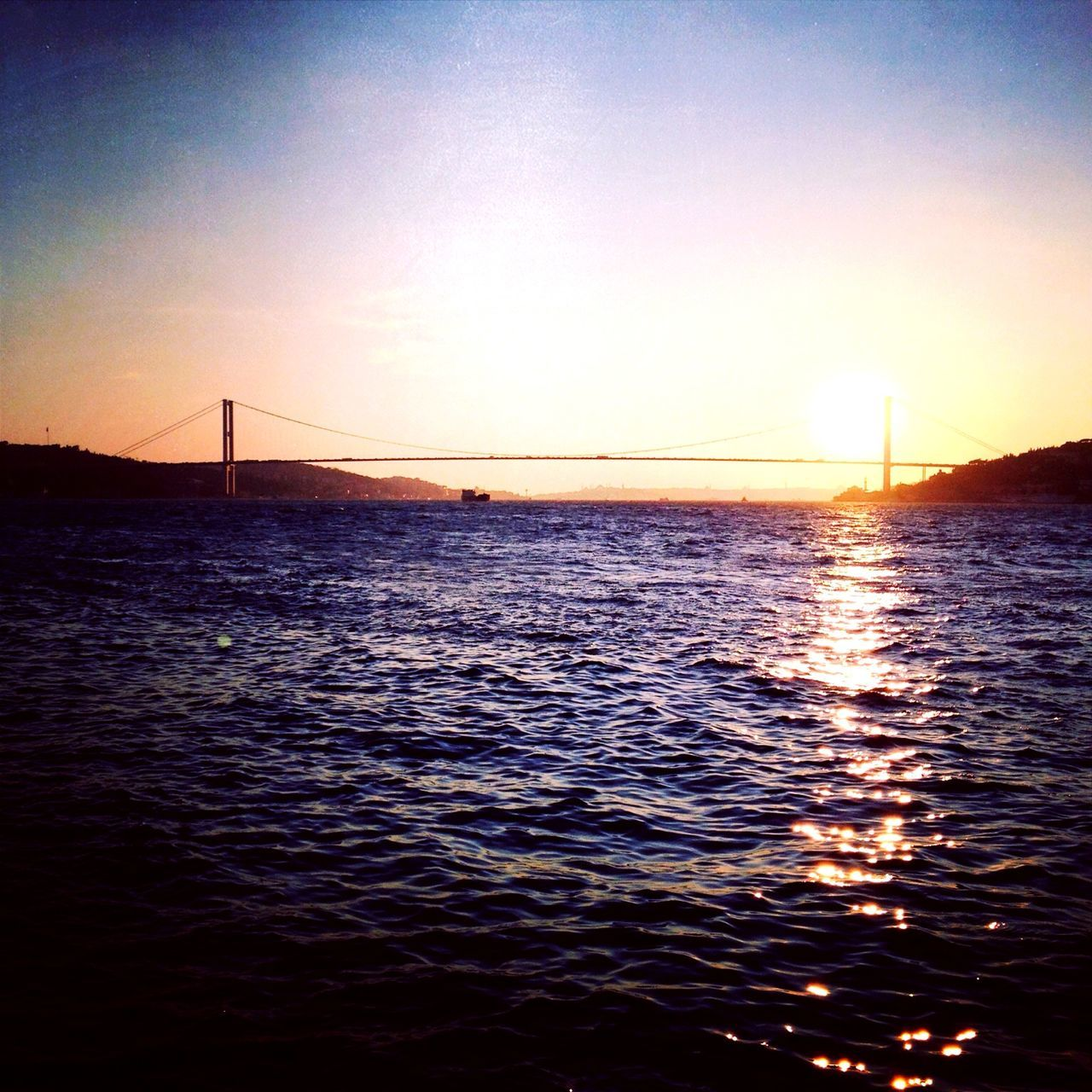 water, sky, bridge, connection, bridge - man made structure, sunset, built structure, sea, waterfront, transportation, architecture, suspension bridge, no people, nature, silhouette, beauty in nature, scenics - nature, tranquility, outdoors, sun, sailboat, bay