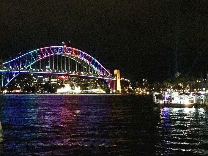 Izzymaxie Vivid Sydney 2016 Sydney Harbour Bridge alight with vivid colourful lights VIVID Sydney Harbourbridge Water Reflections Waterview Colourful Australian Landscape Travel Australia
