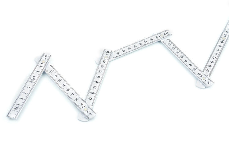Close-up of ruler against white background
