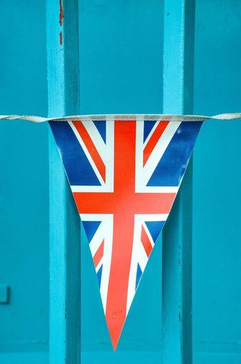Close-up of flag against blue sky