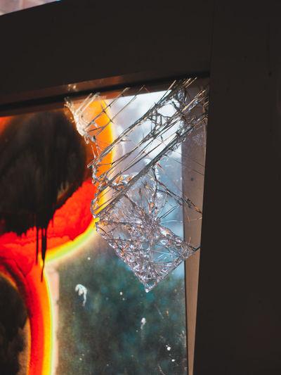 Low angle view of illuminated lighting equipment hanging on window