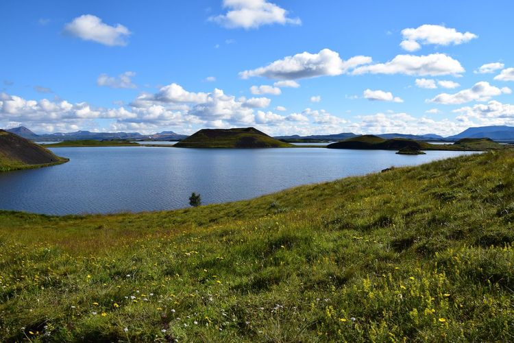 Scenic view of lake myvatn by mountains against sky