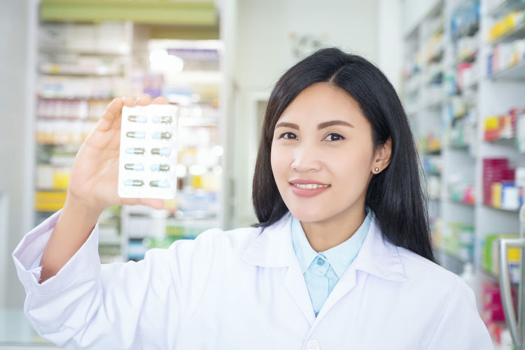 Woman Pharmacy Old White Health Pharmacist Smiling Smile Medicine Holding Drugstore Beautiful Helping Pills Young Female Girl Mature Elderly Vitamins Care Healthcare Treatment Blonde Shop Background Chemist Medicament Modern Healthy Attractive Hand Up Medical Grey Hands Blue Nice Beauty Charming Middle Effective People person Happy Business Portrait Adult Caucasian Tablet