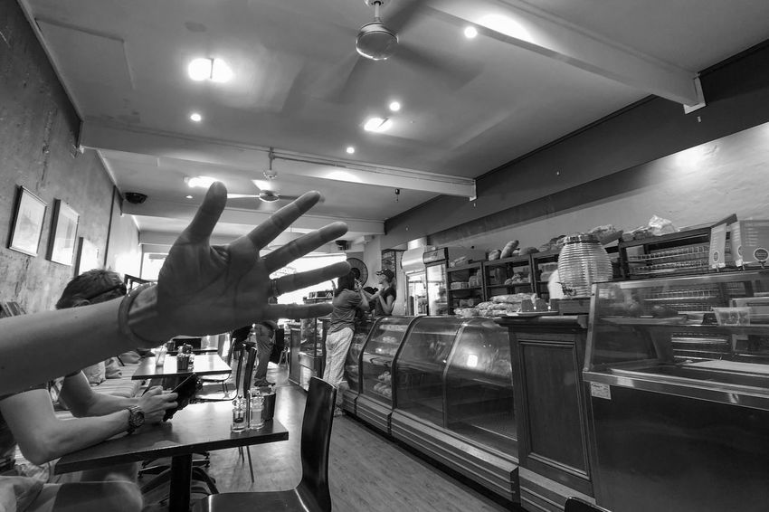 In the cafe Monochrome Light And Shadow Black And White Indoors  Buying Retail  Store Leisure Activity Lifestyles People Real People Food Human Hand Human Body Part Crowd