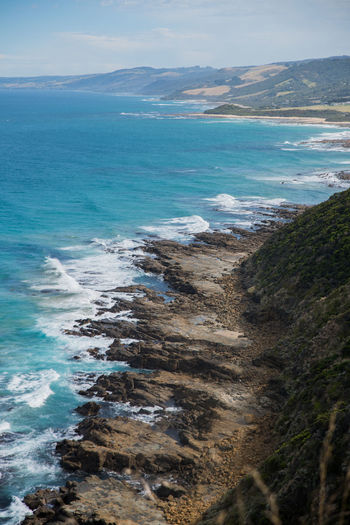 Australia, Great Ocean Road Nature Beach Beauty In Nature Day Horizon Over Water Land Motion Mountain Nature Outdoors Scenics - Nature Sea Tranquil Scene Water Wave