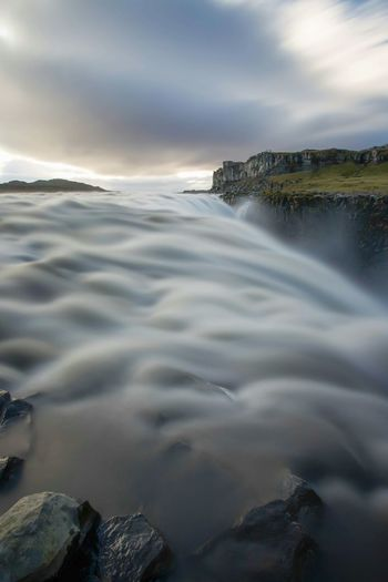 Blurred motion of dettifoss waterfall against sky