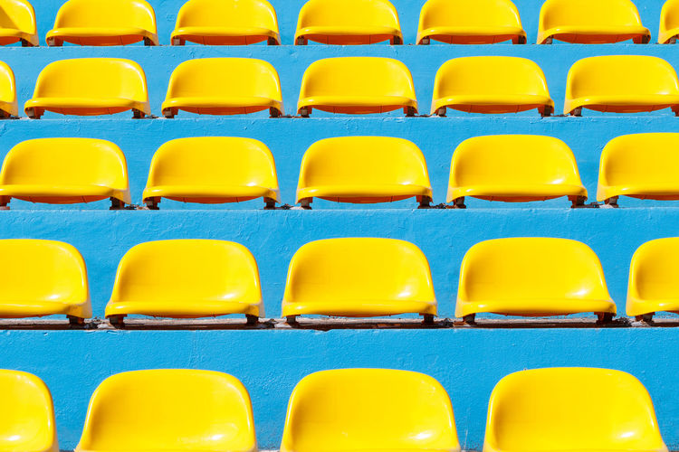 Full frame shot of chairs at stadium