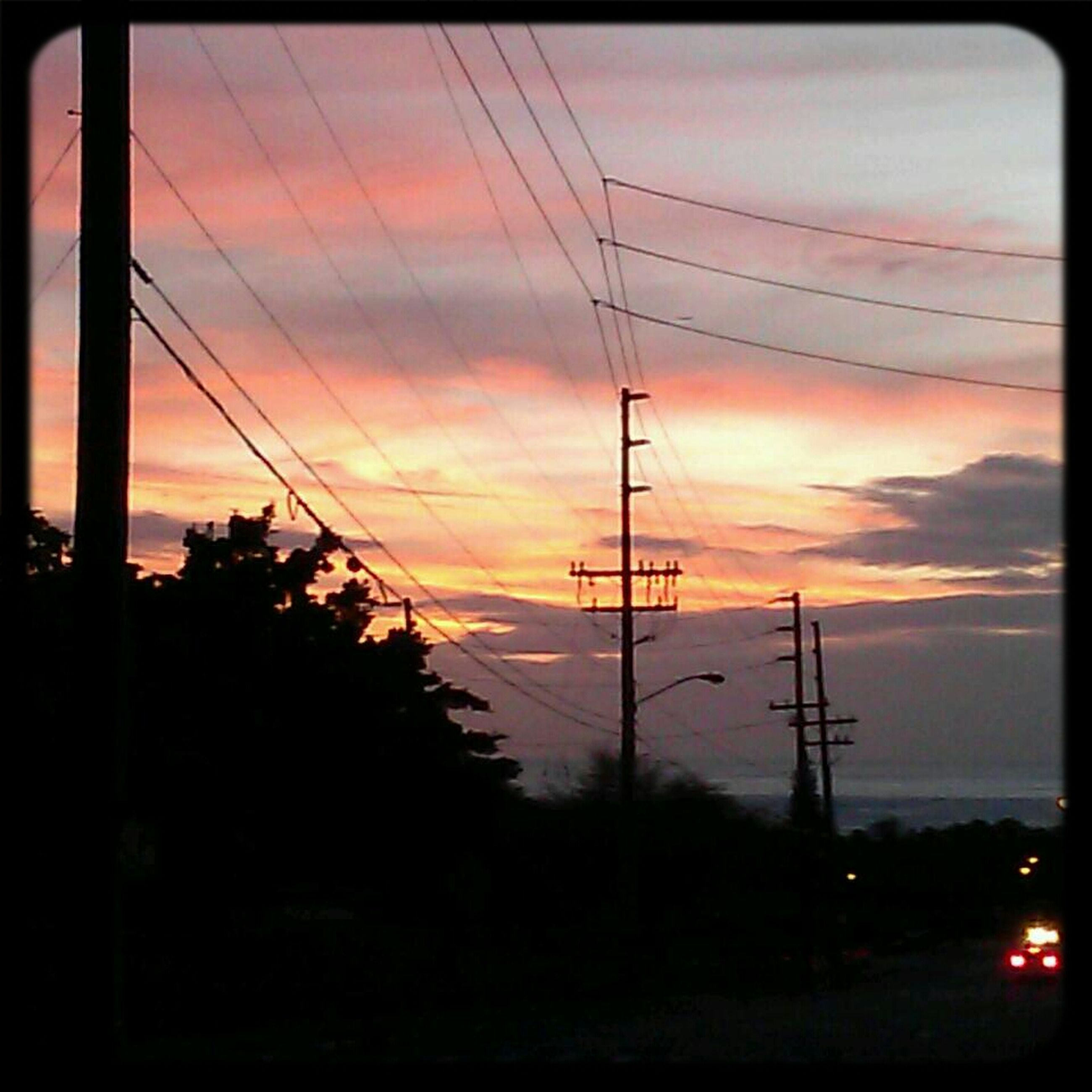 sunset, power line, electricity pylon, electricity, power supply, silhouette, sky, transfer print, fuel and power generation, connection, cable, orange color, technology, cloud - sky, auto post production filter, beauty in nature, scenics, tree, power cable, nature