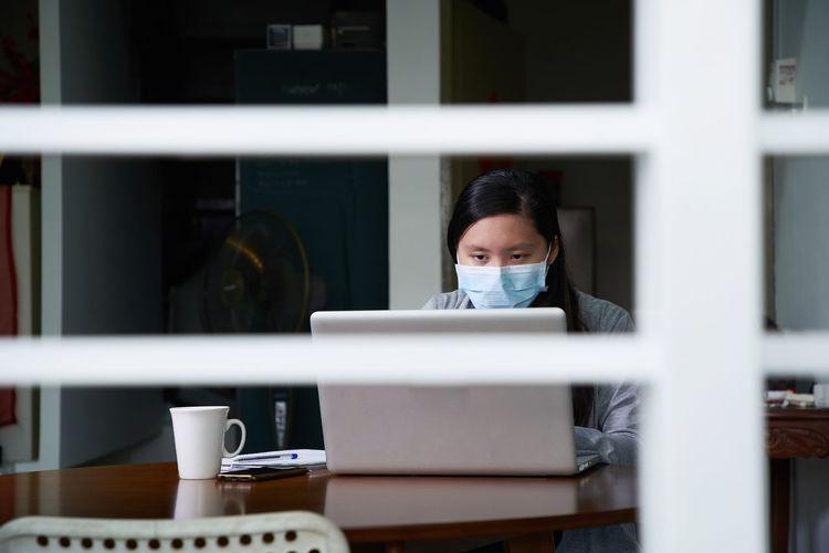 Portrait of woman on window