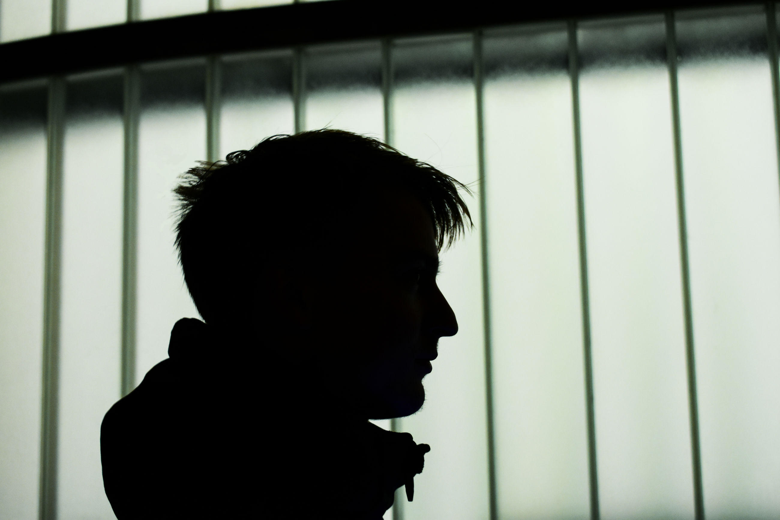 CLOSE-UP PORTRAIT OF SILHOUETTE MAN LOOKING AT WINDOW
