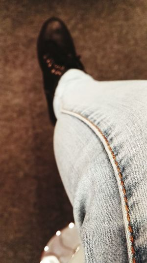 Stitches. Boots Stitch Stitching Jeans Brown Blue Carpet Human Body Part Human Woman Colors person Fashion Fashion Photography EyeEm Selects Low Section Human Leg Men Sitting Close-up Sock Knee Leg Skin Thigh Human Knee Shoe Foot Human Foot Flat Shoe