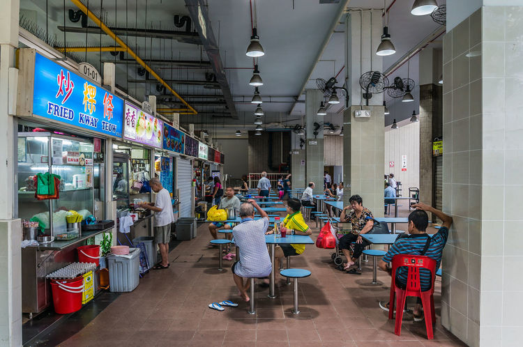 SINGAPORE/SINGAPORE - DEC 23, 2015: Amoy street food centre, hawker centre with people having their meals or waiting for food in the morning on Dec 23, 2015. Abundance Arrangement Choice Collection Day Display Empty Food And Drink Hawker Hawker Centre Hawker Food Hawkers Large Group Of Objects Market Market Stall Modern Multi Colored Retail  Shelf Shop Singapore Store Variation