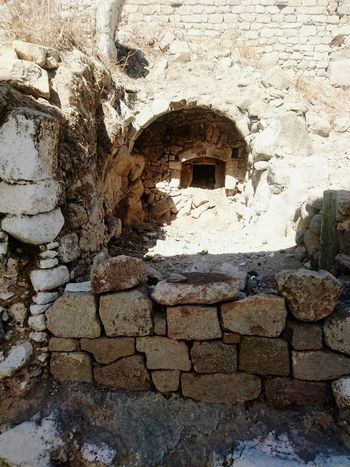Architecture Built Structure Stone Wall Window Building Exterior Wall - Building Feature History Full Frame Old Backgrounds Old Ruin Stone Material Arch Sunny The Past Day Damaged Outdoors Weathered Ancient Nikia Nisyros Greek Greece Vacations
