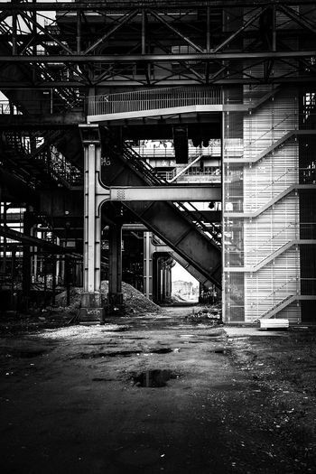 Bnw_stairways Blackandwhite Photography Abondoned Buildings Industrial Architecture Built Structure Building Exterior Transportation No People Street Bnw_repetition Architecture Industry Ruined Building Abandoned Outdoors Architecture Architectural Column Industry
