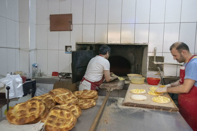 Food And Drink Food Kitchen Indoors  Domestic Room Preparation  Bakery Standing Baked Real People Preparing Food Freshness Men People Bread Adult Making Two People Holding Occupation Baked Pastry Item Chef Pide Ramazanpidesi Fırın