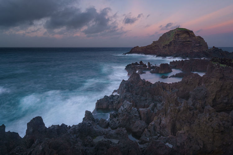 Mole islet landscape in Porto Moniz in Madeira at sunset Madeira Portugal Island Ilha Travel Landscape Nature Mountain Porto Moniz Panorama Panoramic Rock Water Beach Tranquility Best  Mole Islet Mole Ilhéu Mole Sunset Sunrise Waves Lighthouse Seascape Aerial View
