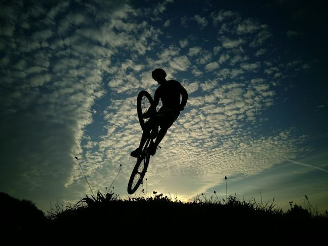 Silhouette Sky Full Length Men Cloud Low Angle View Cloud - Sky Exploration Beauty In Nature Outline Cloudy Carefree Tranquil Scene Tranquility Outdoors Nature Plant Day Scenics Solitude Slopestyle MTB Jump Jumpshot