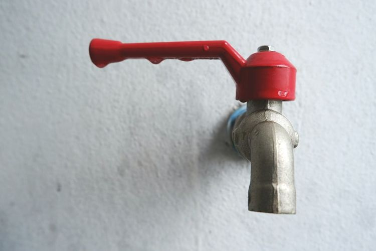 Close-up of faucet on wall