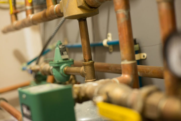 Radiant floor heating system utility room. Business Close-up Control Equipment Factory Heating System Indoors  Industry Machine Part Machine Valve Machinery Manufacturing Equipment Metal No People Pipe - Tube Production Line Radiant Floor Selective Focus Skill  Technology Textile Industry Valve Workshop