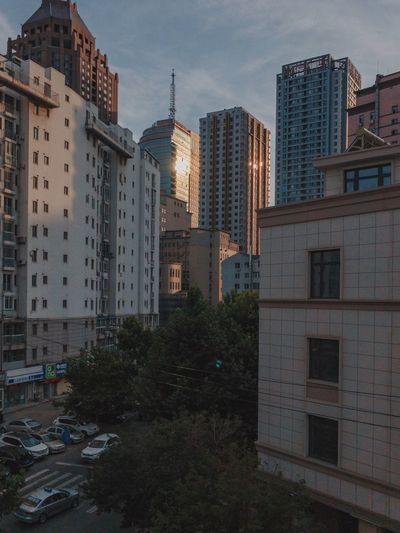 Dalian, Liaoning, China 2017 MelbournePhotographer IPhoneography Mobilephotography ShotoniPhone6s Adobelightroommobile Vscocam Architecture Building Exterior Built Structure Skyscraper City Sky No People Outdoors Modern Day Cityscape