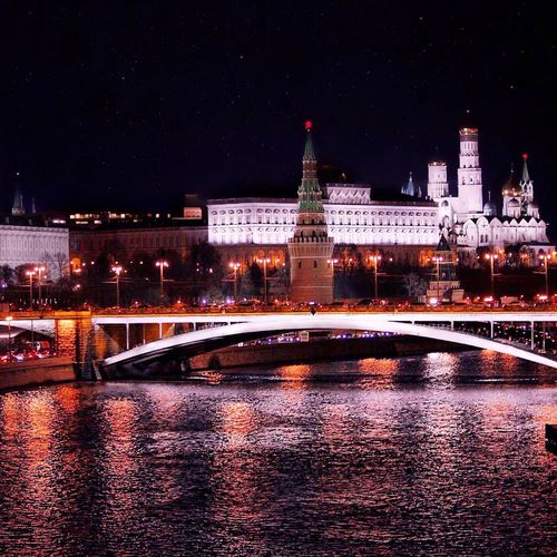 Spasskaya tower in front of moscva river at night