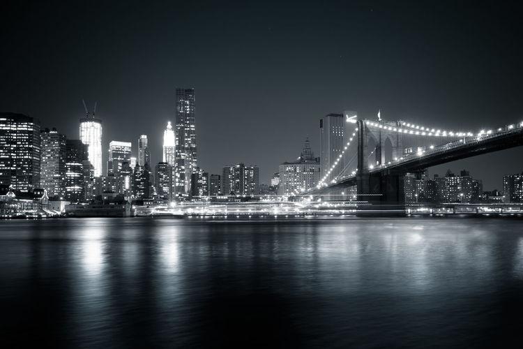 Manhattan at night Brooklyn Bridge / New York City Long Exposure Manhattan New York Night No People River Water