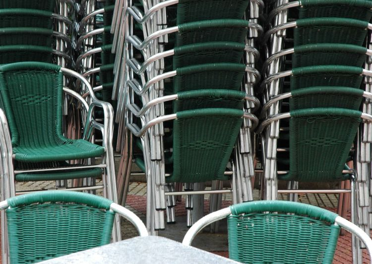 Green chairs arranged outdoors