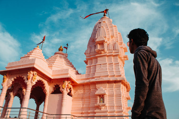 Architecture Sky Built Structure Building Exterior Cloud - Sky Nature Religion Rear View Building Men Low Angle View Two People Belief People Day Place Of Worship Spirituality History Real People The Past Outdoors Looking At View