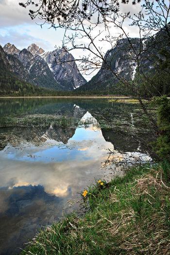 Lago di Dobbiaco alias Toblacher See in Dolomite Alps, South Tirol, Italy Dolomite, Italy, Lago Di Dobbiaco, South Tirol, Toblacher See, Alpin, Alps, European, Ice, Lake, Landscapes, Mountains, Nature, Outdoors, Range, Rock, Sky, Snow, Springtime, Stone, Travel, Vacations, Valley Lago Di Dobbiaco Toblacher See South Tirol Dolomites, Italy Lake Landscape Italy