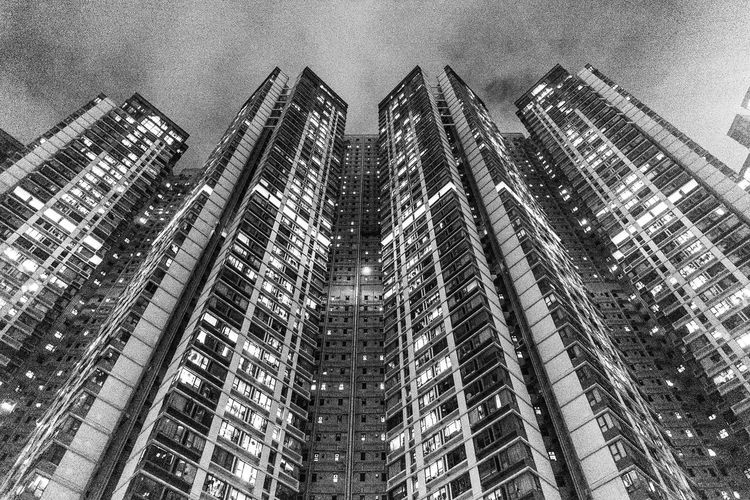 Low angle view of modern buildings in city at night