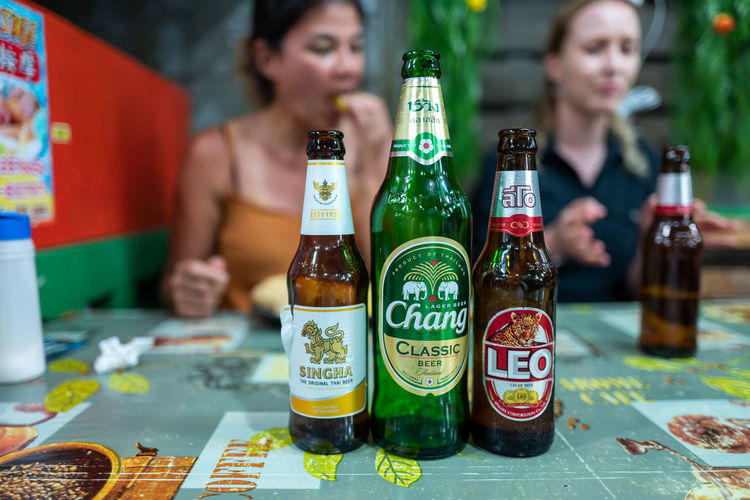 Koh Lipe Bottle Container Alcohol Drink Food And Drink Refreshment Table Focus On Foreground Indoors  Beer Beer - Alcohol Bar - Drink Establishment Real People Beer Bottle Business Still Life Glass - Material Adult Glass Food Drinking