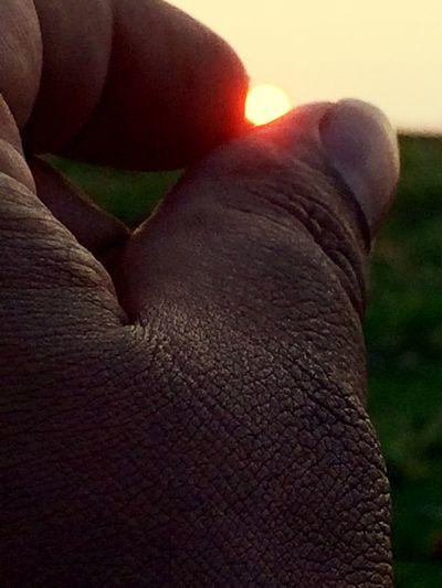 Sun Set through my fingers