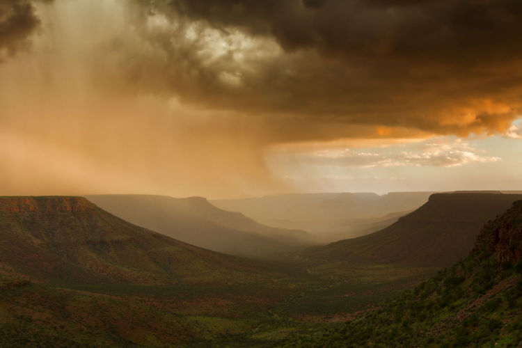 Thunderstorm over the Grootberg plateau, Namibia, Africa Grootberg Grootberg Plateau Namibia Africa Beauty In Nature Cloud - Sky Landscape Mountain No People Scenics - Nature Sky Storm Sunset Thunderstorm Tranquil Scene Tranquility