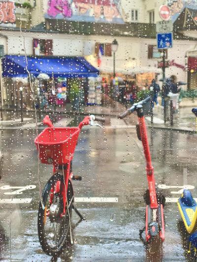 Bicycles on wet street during rainy season
