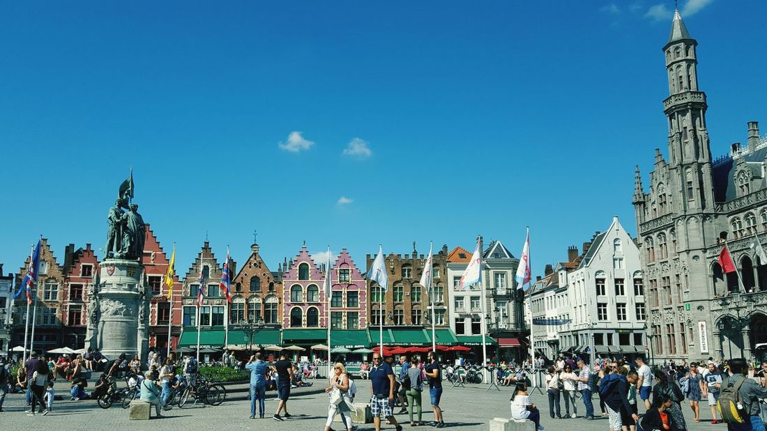 Large Group Of People City Travel Destinations People Celebration Architecture Outdoors Sky Crowd Day Adults Only Building Exterior City Brugge Bruges Cityscape Old Town Travel Destination Flanders Flandres  Built Structure Architecture History Cultures Urban Skyline