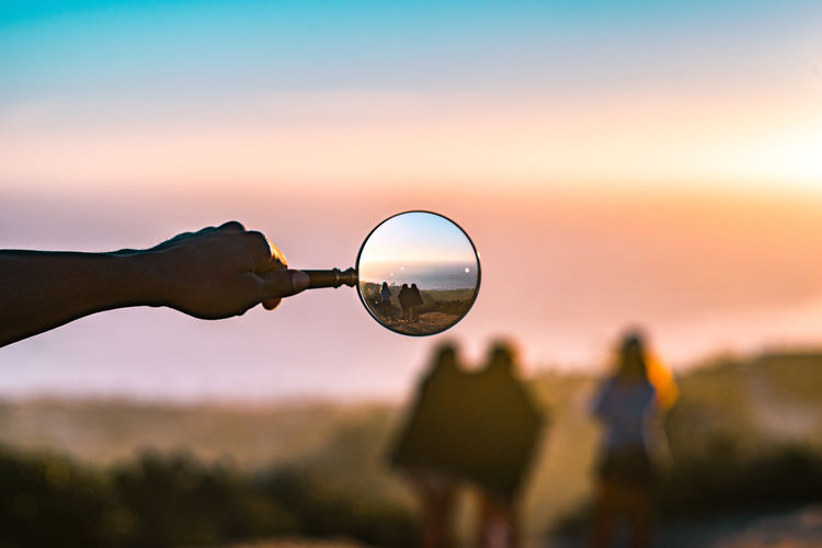 I was playing around with shooting through a magnifying glass and found three friends enjoying the sunset. Beauty In Nature Califonia California Circle Focus On Foreground Friends Geometric Shape Girls Magnify Magnifying Glass Nature Outdoors People Together Selective Focus Sky Sphere Sunset Lieblingsteil Visual Creativity