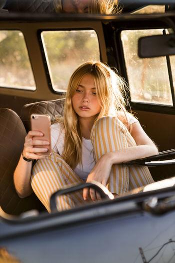 Portrait of a girl sitting in car