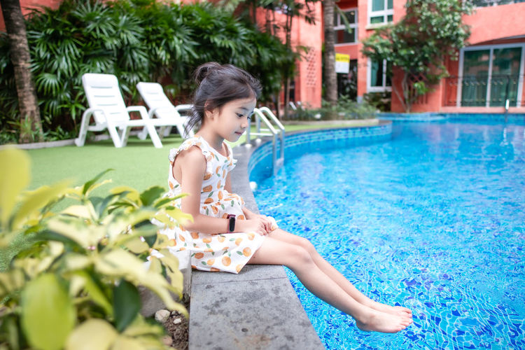Young woman looking at swimming pool
