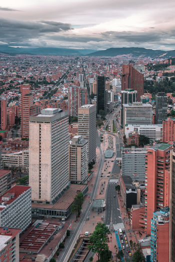 Bogotá from one of the highest buildings. Architecture Built Structure High Angle View City Building Exterior City Life Aerial View South America Clouds And Sky Outdoors Urbex Urban Crowd Transportation Mode Of Transportation Highway Street Travel Destinations Residential District Cityscape Skyscraper Office Building Exterior Crowded Modern Financial District