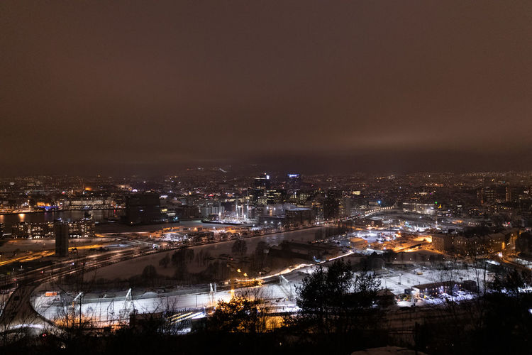Oslo city during night time City Illuminated Architecture Building Exterior Cityscape Built Structure Night Sky Nature Building No People High Angle View Residential District City Life Copy Space Outdoors Glowing Water City Cityscape Nightlife Lifestyles Modern
