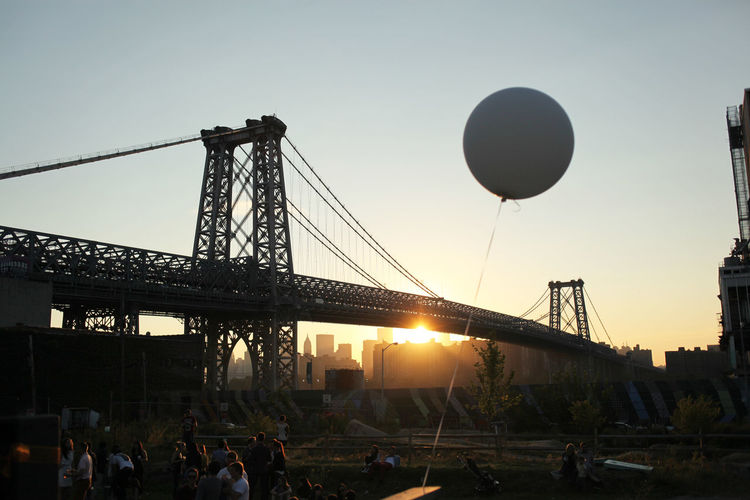 Sunset at a private party in a park that is now the site of a condo. Balloon Bridge Built Structure Lens Flare New York NYC NYC Photography Sky Summer Sun Sunbeam Sunset Travel Destinations Williamsburg Bridge Williamsburg, Brooklyn