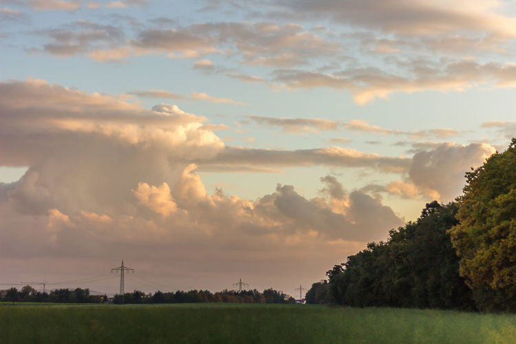 Beauty In Nature Cloud - Sky Day Field Grass Landscape Nature No People Outdoors Rural Scene Scenics Sky Sunset Technology Tranquility Tree