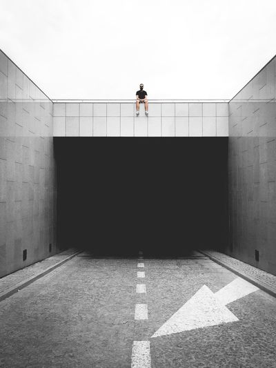 Man sitting on top of a tunnel