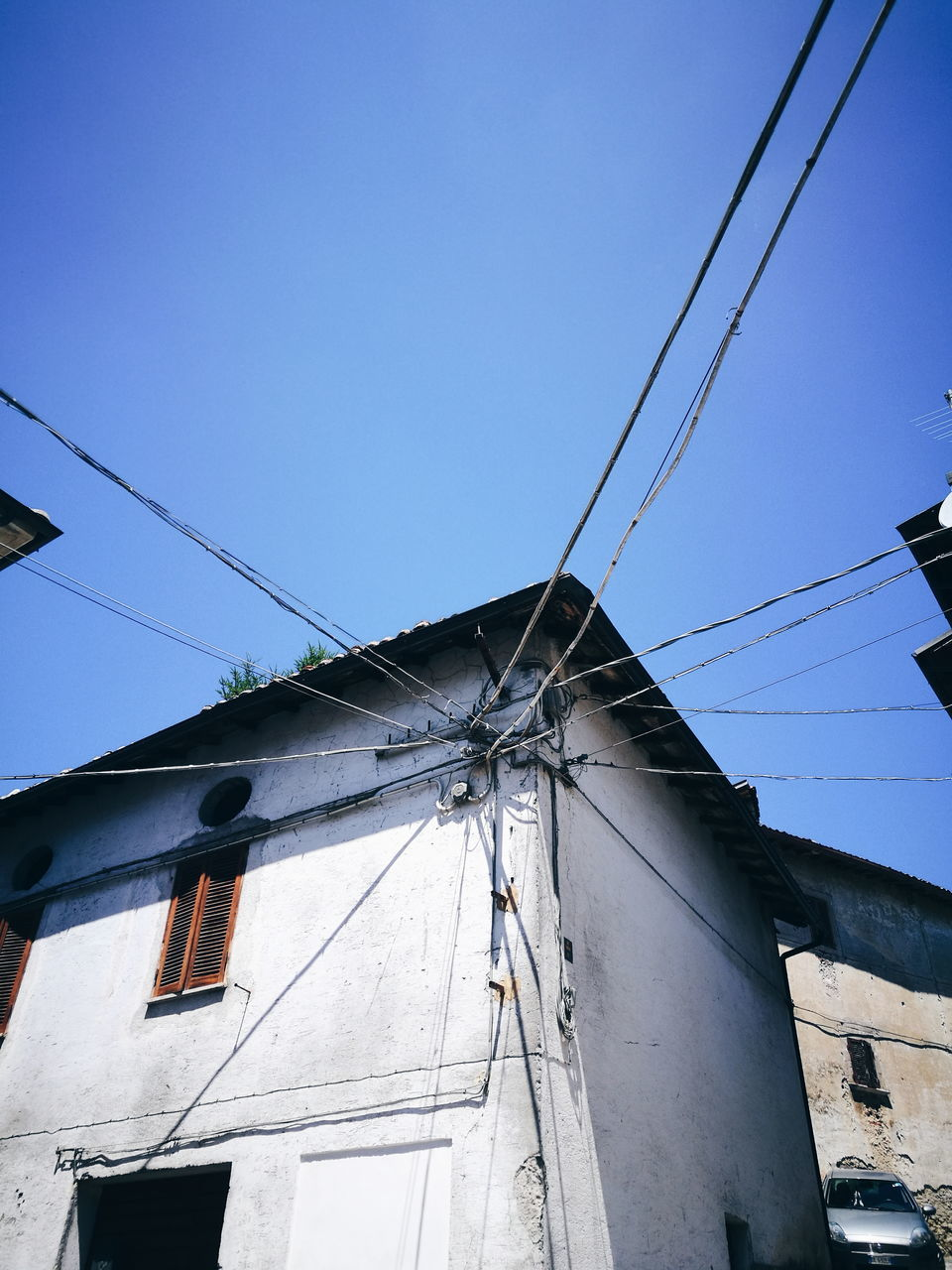 cable, building exterior, low angle view, architecture, built structure, no people, outdoors, day, clear sky, blue, sky