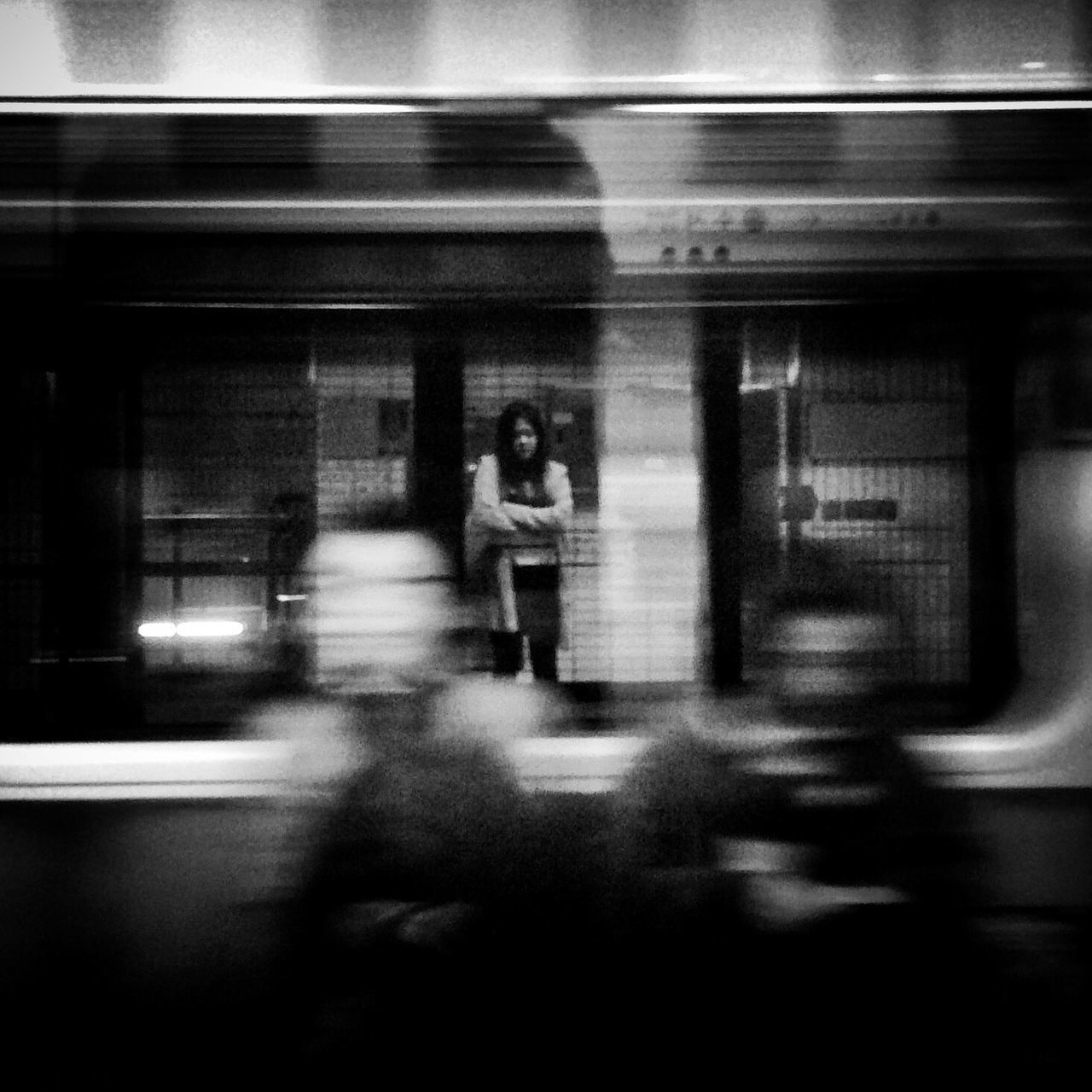 BLURRED MOTION OF WOMAN IN CAR